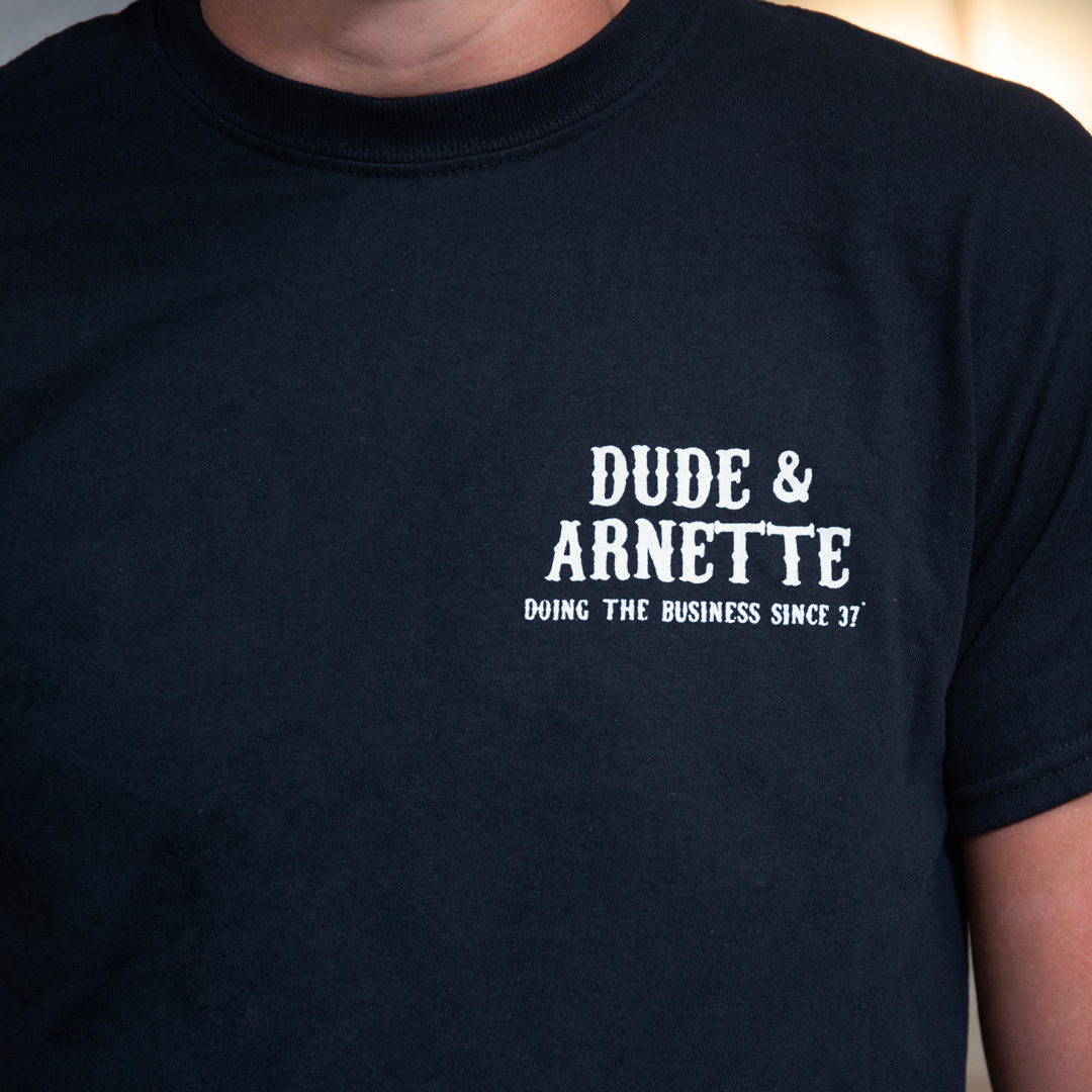 Black tshirt with dude and arnette text on it