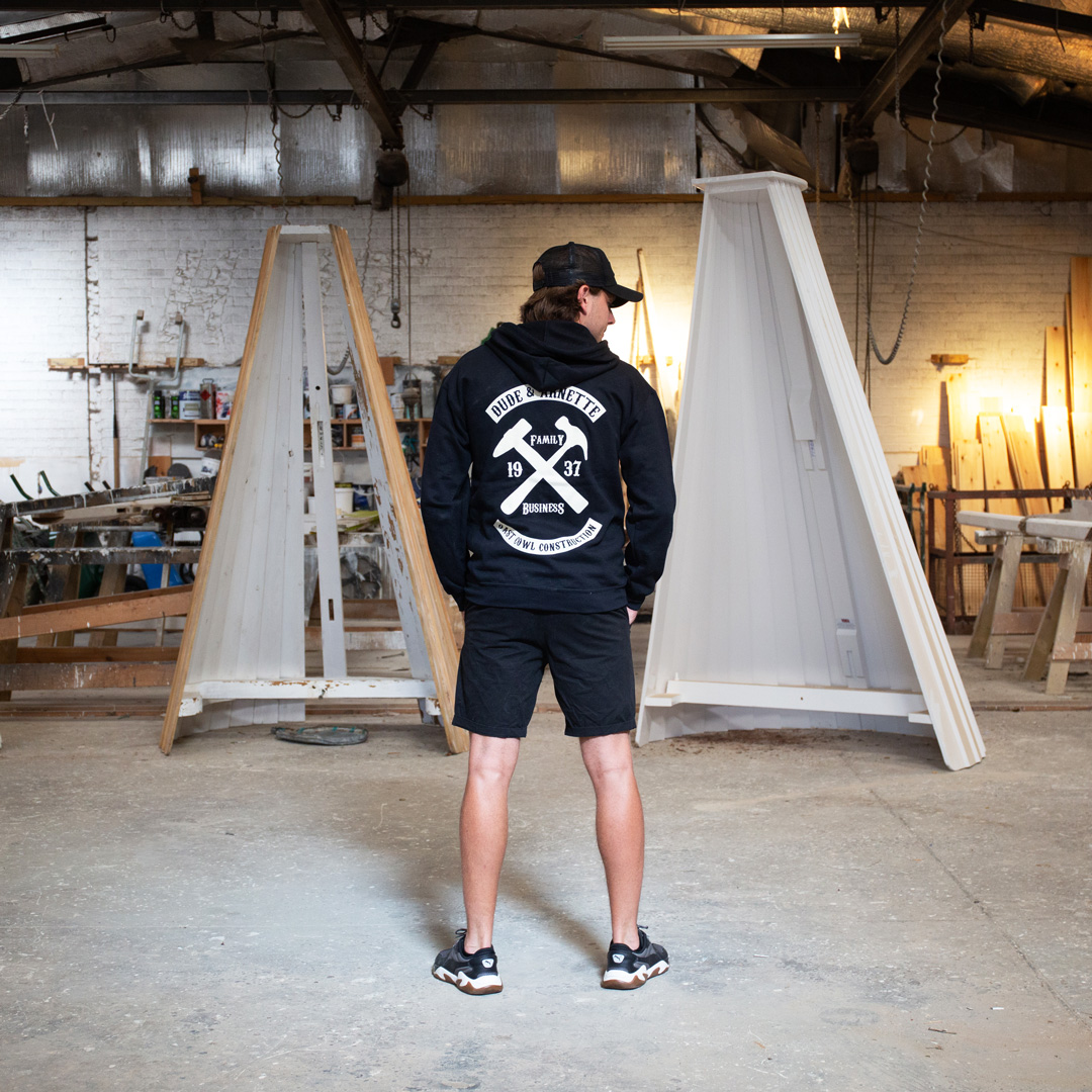man modelling a black D&A hoodie from afar