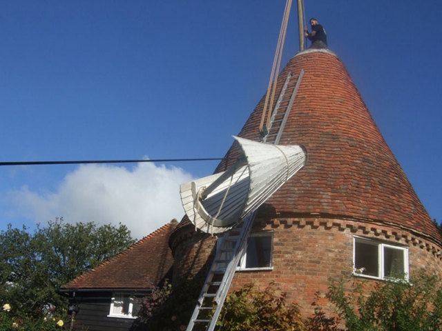 View of an oast cowl being transported to a roof