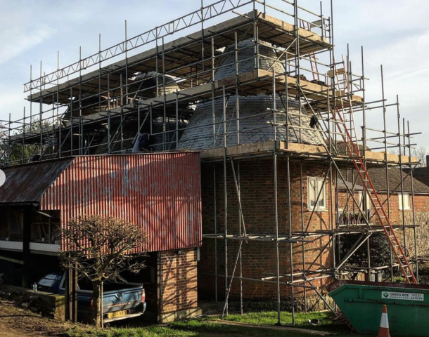 scaffolding around an oast house