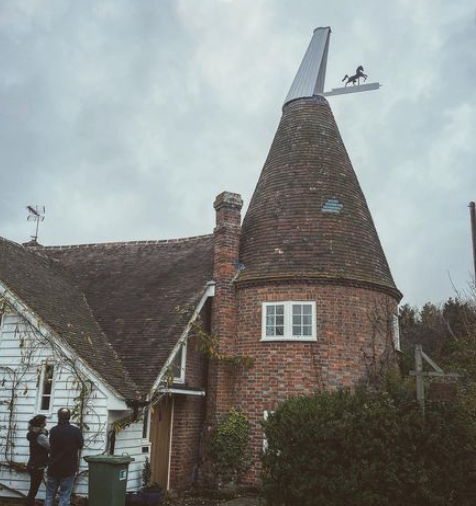 repaired and fixed oast cowl on oast house